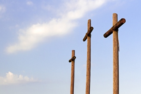 Three Wooden Crosses and Blue Sky