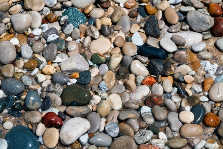 polished: Polished, wet rocks on the beach at Pointe Betsie on Michigan