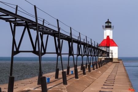 North Pier Light with elevated catwalk approach in St. Joseph, Michigan photo