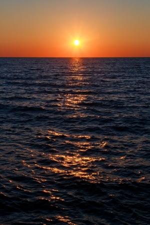 ludington: The setting sun shines across the waters of Lake Michigan.