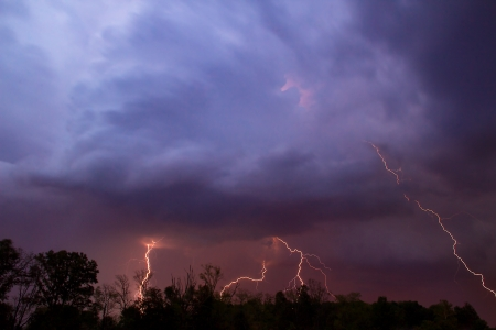extreme weather: Multiple lightning strikes from colorful evening storm clouds Stock Photo