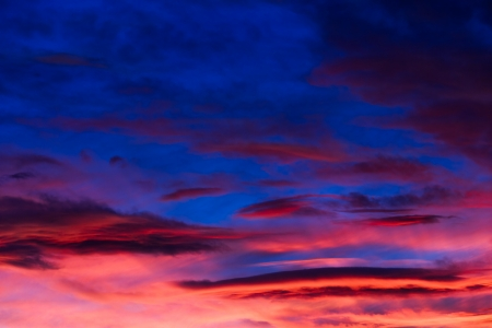 intensely: An intensely colorful sunset sky with clouds