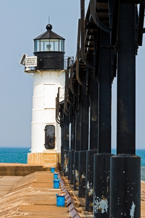 The outer light on the North Pier at St. Joseph, Michigan with Lake Michigan behind. photo