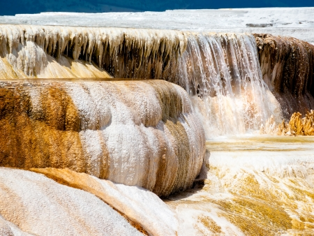 water feature: Water pours over a deposited limestone terrace at Mammoth Hot SPrings in Yellowstone National Park, Wyoming.