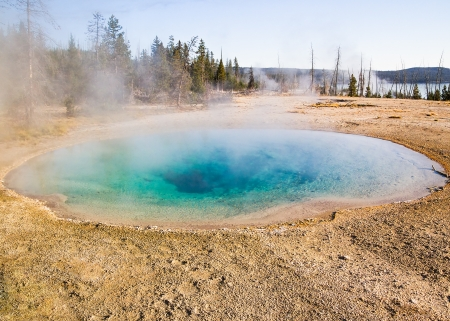 Blue Funnel Spring is one of several thermal pools in the West Thumb Geyser Basin of Yellowstone National Park, Wyoming, USA  Stock Photo - 18483548