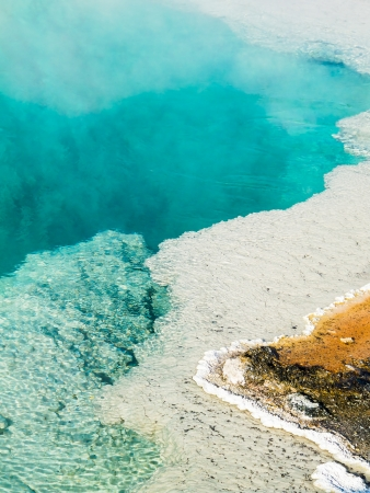 water feature: Steam rises from a beautiful deep blue hot spring pool at West Thumb Geyser Basin in Yellowstone National Park, Wyoming, USA