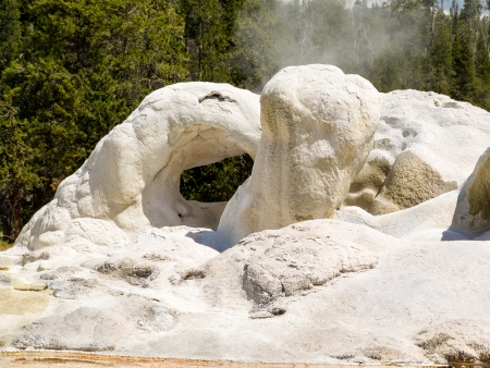 Grotto Geyser emits steam in Yellowstone National Park s Upper Geyser Basin Stock Photo - 18543690