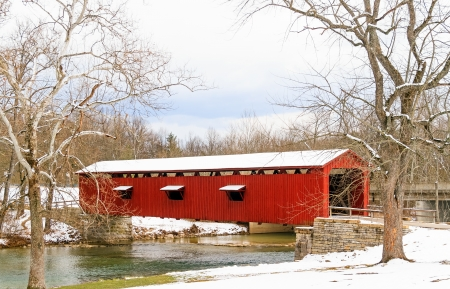 Indiana s Cataract Falls Covered Bridge, spanning Fall Creek, was constructed in 1876 in Owen County  photo