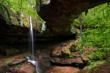 geological formation: The Rockbridge is a geological formation in Hocking County, Ohio  A small waterfall plunges between the hillside and the natural bridge, spanning nearly 100 feet across a ravine