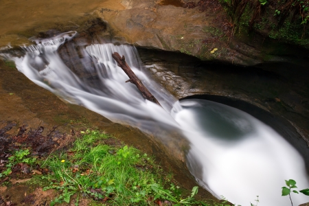 Swirling waters in the Upper Gorge at Old Mans Cave in Ohios Hocking Hills have eroded a pothole in the stone streambed called The Devils Bathtub. photo