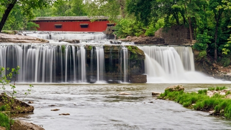 cataract falls: A red covered bridge crosses Mill Creek just upstream from Upper Cataract Falls with old mill ruins visible on the right side