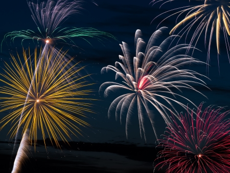Colorful fireworks light the evening sky in celebration  photo