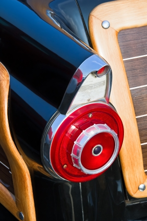 Taillights fin of a 1955 station wagon with woodie paneling