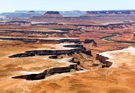 cut through: The jagged canyon cut through a desert landscape by Utah