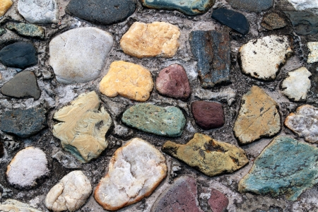 A old roadway is constructed of colorful, assorted cobblestones  photo