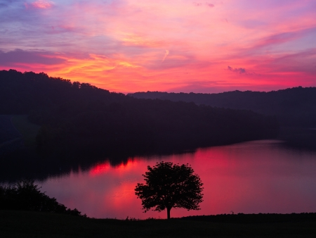 A colorful sunrise sky is reflected on the waters of Kentucky
