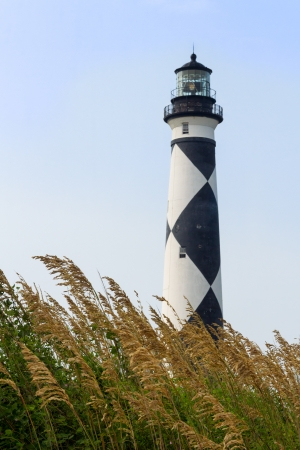 and distinctive: The Cape Lookout Lighthouse, with its distinctive back and white diamond pattern, stands on North Carolina Stock Photo