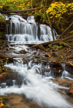 wagner: Wagner Falls, a Michigan State Scenic Site, is photographed with a long exposure and autumn foliage