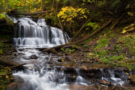 Wagner Falls is a beautiful waterfall near Munising, Michigan photographed here with fall foliage and a long exposure for silky smooth flowing whitewater  photo