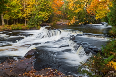 Bond Falls, a waterfall in Michigan s Upper Peninsual with fall foliage photo