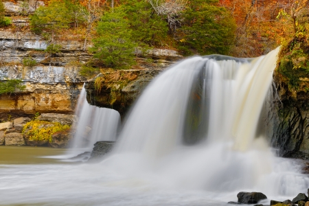cataract falls: Indiana s Upper Cataract Falls pour through boulder int he midst of fall foliage color