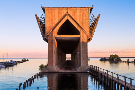 marquette: The old ore dock in the harbor at Marquette, Michigan, now abandoned, was used to unload railway ore cars into ships below  Stock Photo