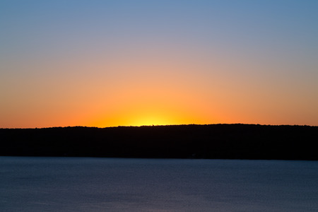 skyscape: A beautiful sunrise fills the sky with gorgeous color over South Bay by Munising, Michigan