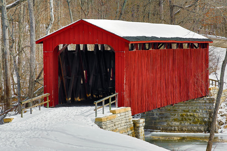 cataract falls: The red Cataract Falls Covered Bridge crosses Mill Creek in a snowy Indiana landscape