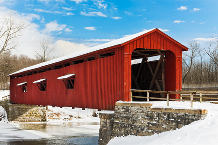 The red Cataract Falls Covered Bridge crosses Indiana photo