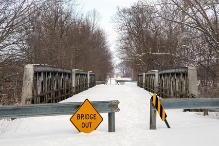 indian creek: A snowy old triple pony truss bridge spanning Indian Creek Stock Photo