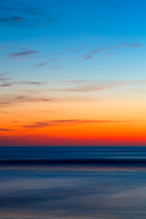 dawning: The rising sun paints the horizon with intense color over the Atlantic Ocean on a Florida beach  Stock Photo