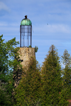 greatly: The Old Lighthouse at Baileys Harbor in Door County Wisconsin is one of a handful of existing beacons with a birdcage lantern room  First used in 1853, the landmark has greatly deteriorated
