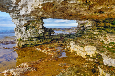 stoney point: A rocky arch looks out on the waters of Lake Michigan at Door County Wisconsin