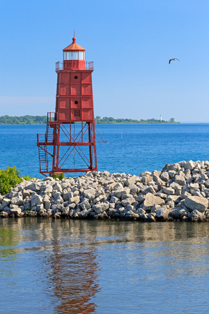 The Racine, Wisconsin North Breakwater Lighthouse is backed by the lighthouse at Wind Point on the distant horizon  photo