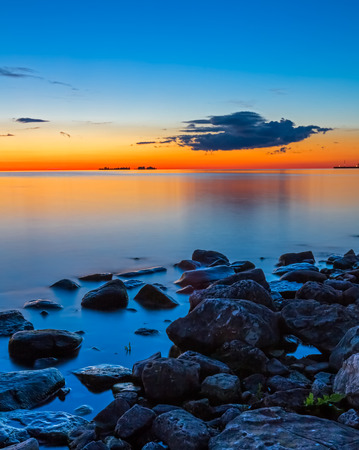 surreal landscape: The afterglow of sunset paints the water and sky with intense and beautiful colors at Sister Bay, Wisconsin.