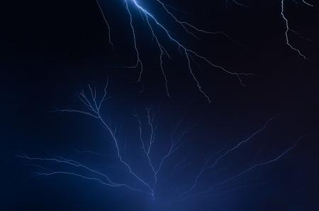 american midwest: Multiple lightning bolts fill the night sky over the American Midwest during a summer thunderstorm.
