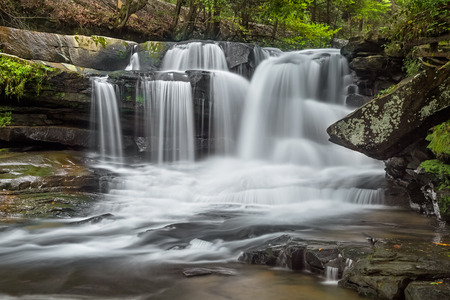 Dunloup Falls on Dunloup Creek is an exceptionally beautiful West Virginia waterfall about two miles from the New River and the old railroad town of Thurmond. photo