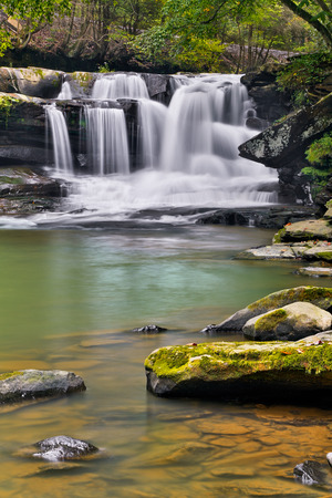 Dunloup Falls on Dunloup Creek is a beautiful West Virginia waterfall about two miles from the New River and the old abandoned railroad boom town of Thurmond. photo