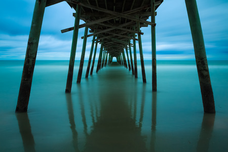 carolina: Ocean surf at the Bogue Inlet Fishing Pier, in Emerald Isle, North Carolina, is photographed with a very long exposure prior to sunrise.