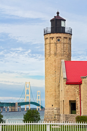 huron: The Old Mackinac Point Lighthouse is backed by the Mackinac Bridge, one of the world greates suspension bridges. Stock Photo