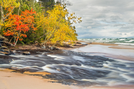 confluence: Michigans Hurricane River flows across the beach and into Lake Superior at Pictured Rocks National Lakeshore.