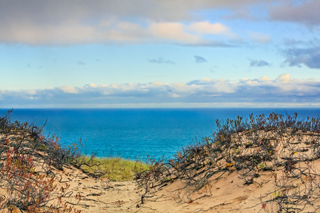 The light of early morning illumines the landscape of Grand Sable Dunes and Lake Superior at Upper Peninsula Michigan\\\\