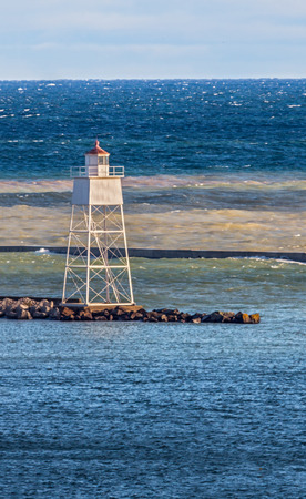 upper peninsula: The Inner Range Light marks the harbor at the small Upper Peninsula Michigan town of Grand Marais on Lake Superior.