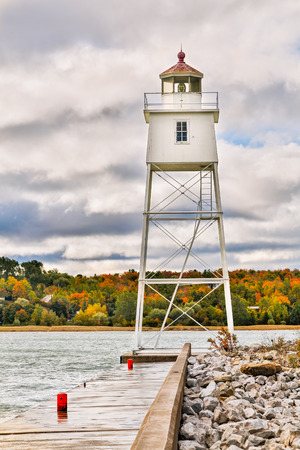 navigational light: A metal tower lighthouse marks the harbor at Grand Marais on Lake Superior in Michigan