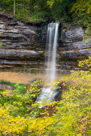 alger: Colorful fall leaves surround Munising Falls, a beautiful waterfall in Upper Peninsula Michigans Pictured Rocks National Lakeshore. Stock Photo