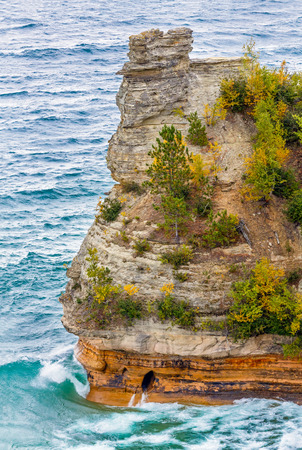 Powerful Lake Superior waves crash at the base of Miners Castle, a rock formation in Upper Peninsula Michigan