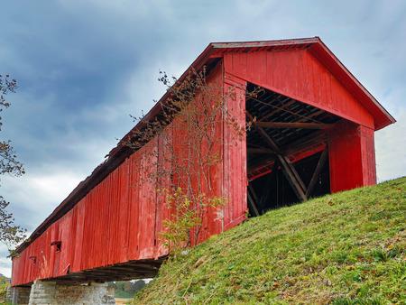 The historic Houck Covered Bridge, built in 1880, crosses Big Walnut Creek in rural Putnam County Indiana. Stock Photo