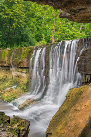 rock strata: Water flows over the rock ledge of Anderson Falls, a waterfall east of Columbus, Indiana.