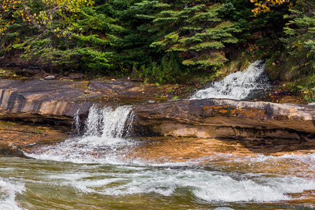 elliot: Elliot Falls, a small beautiful waterfall in Michigans Upper Peninsula, spills into Lake Superior at Miners Beach in Pictured Rocks National Lakeshore. Stock Photo