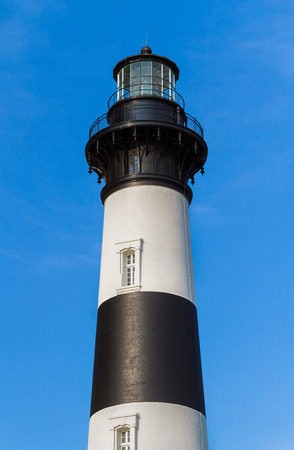 nags: The black and white striped tower of the Bodie Island LIghthouse stands against a deep blue North Carolina sky.